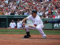 A Red Sox batter playing a bunt (© Parkerjh, CC-BY-3.0)