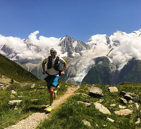 A runner runs on a high-altitude route in Chamonix, France