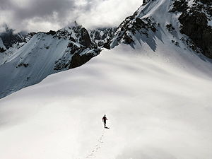 A person walking from Aiguile du Midi into the mountains