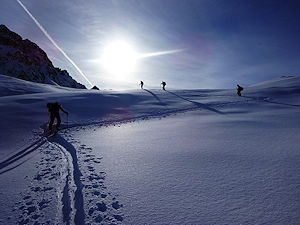 A group of skiers going off-road at Chamonix Mont Blanc
