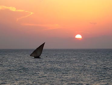 A dhow in the sunset off the Zanzibar coast