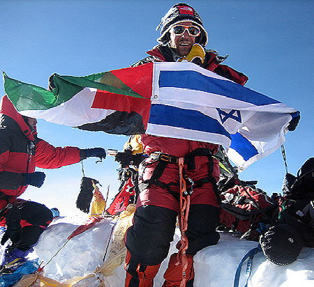 he Everest Peace Project holding sewed flags from Palestine and Israel