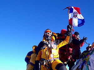 Climber at the summit of Mount Everest wearing an oxygen mask