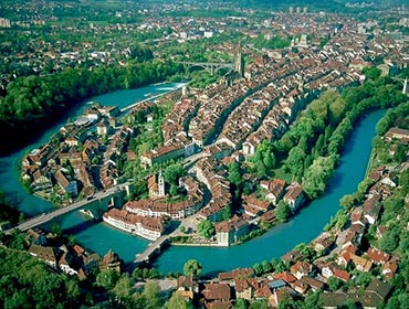 An aerial view of Bern's Old Town, surrounded by the turquoise River Aare