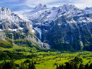 The lush valleys and snow-capped peaks of Grindelwald, Switzerland
