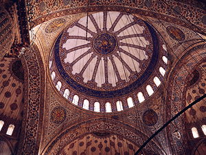 The beautiful paintings inside the dome of the Blue Mosque in Istanbul