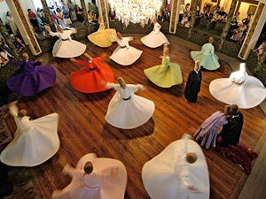 Whirling Dervishes from Turkey. They belong to a Sufi Islamic sect called the Mevlevi founded by the famous philosopher Mevlana. Picture was taken from the top viewing gallery.