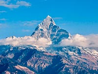 The stunningly beautiful Machapuchare peak, as seen from Pokhara (© Nancy Collins, distributed under a Creative Commons ASA 3.0 licence).