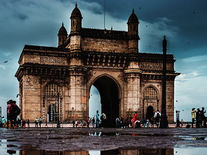 The Gateway of India is an impressive yellow basalt monument