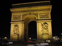 The Arc de Triomphe at night.