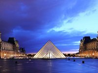 The modern pyramid outside Paris' Louvre (© Martin Falbisoner, distributed under a CCASA3.0 Unported licence).