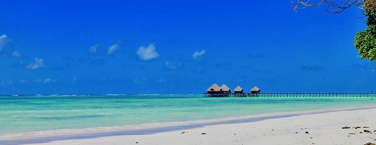 Golden sand and turqoise waters in Zanzibar's tropical paradise