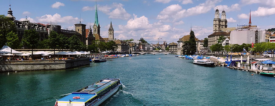 The Limmat in Zurich, looking downstream to Rathausbruecke from Quaibruecke at Lake Zurich, Stadthausquai to the left and Limmatquai to right.