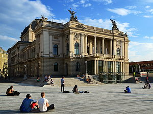 People enjoying a sunny day in front of the Opera House